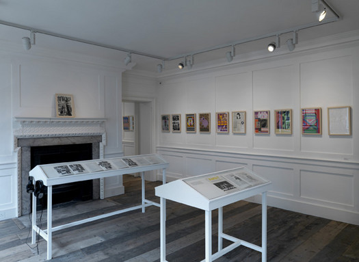 Installation view showing prints and issues of Ambit magazine (in cases)