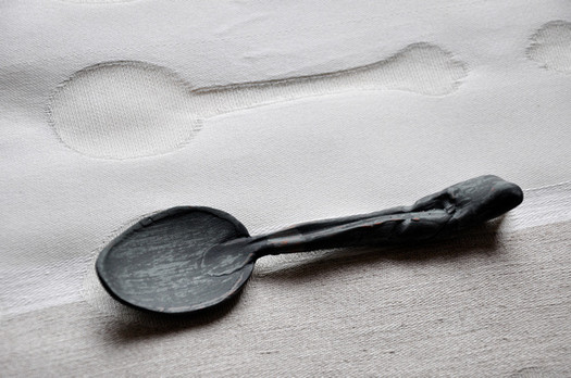 Ceramic spoon with woven cloth shadow