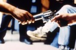 Gun being passed